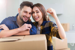 Couple with keys to new home. Happy young couple with keys to new home royalty free stock photo