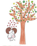 Couple kids kissing under a tree Royalty Free Stock Photo