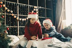 Couple kids Little girl and boy  in santa klaus hat decorating Royalty Free Stock Image