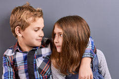 Couple of kids looking at each other. Royalty Free Stock Images