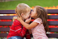 Couple of kids loving each other hugging Stock Images