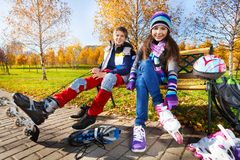 Couple kids skating Stock Photos