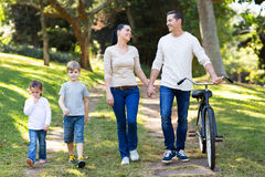 Couple kids walking outdoors Stock Photo