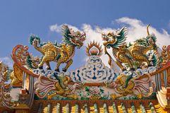 Couple kilins. Of Chinese fables with blue sky royalty free stock images