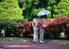 A couple of Kimono girls at rose garden, Kyoto Japan Royalty Free Stock Photos