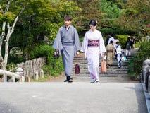 Couple in kimono walking on Kyoto streets Stock Photos