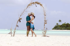 Couple kiss on Honeymoon Island Royalty Free Stock Image
