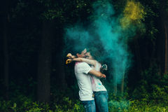 Couple kiss and hugs in paints holi Royalty Free Stock Images