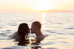 Couple kiss sea suset Stock Image