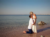 Couple  kissed on beach Stock Image