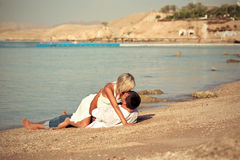 Couple  kissed on beach Stock Photos