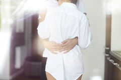 Couple kisses and hugs at kitchen in the morning Stock Images