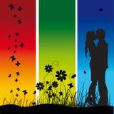 Couple kisses on a meadow. Black silhouette, butterflies Stock Photos