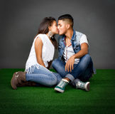 Couple kisses in a park Royalty Free Stock Photo
