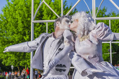 Couple kisses during a performance Royalty Free Stock Image