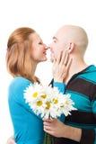 Couple kissig holding flowers Stock Image