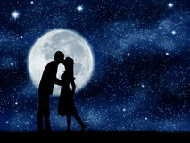 Couple kissing. Couple kissing on the starry sky background.The moon element of this image furnished by NASA Royalty Free Stock Image