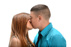 Couple Kissing. Young couple kissing isolated over white background Stock Photography