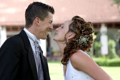 Couple Kissing. A bride and groom kissing on their wedding day Stock Photos