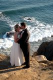 Couple Kissing. Wedding couple kissing on bluffs Stock Photography