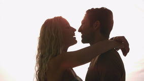 Couple kissing against sunlight stock video footage