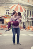 Couple kissing at alley in city. Stock Image