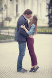 Couple kissing at alley in city. Royalty Free Stock Images
