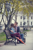Couple kissing at alley in city. Stock Images