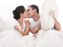 Couple Kissing And Playing On Bed Stock Photography