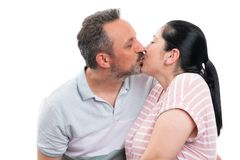 Couple kissing as romantic gesture. Happy men and women couple kissing lips as romantic gesture relationship concept isolated on white background royalty free stock image