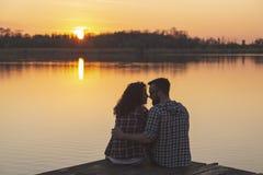 Free Couple Kissing At Lake Docks, Enjoying The Sunset Royalty Free Stock Images - 191777909