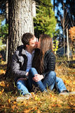 Couple kissing autumn afternoon in the park Royalty Free Stock Image