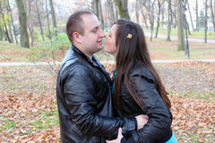Couple kissing in autumn Stock Images