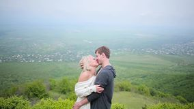 Couple kissing on the background of valley stock footage