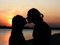 Couple kissing at beach Stock Images