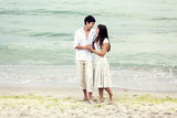 Couple kissing at the beach Stock Images