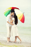 Couple kissing at the beach Stock Photography