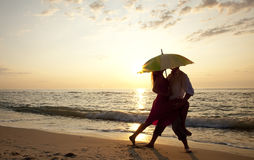 Couple kissing at the beach in sunset. Royalty Free Stock Images
