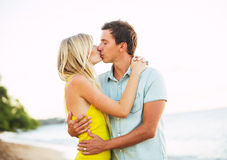Couple Kissing on the Beach at Sunset Stock Photo