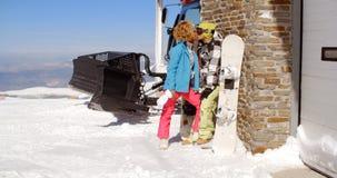 Couple kissing behind ski resort garage Royalty Free Stock Photo