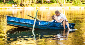 Couple kissing on boat stern Stock Image