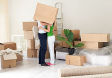 Couple kissing with box on heads Stock Photos