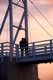 Couple kissing on a bridge Stock Photo