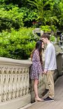 Couple kissing in Central Park. Couple holding hands on Bow Bridge in Central park in New York City royalty free stock photos