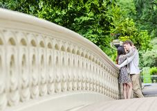 Couple kissing in Central Park in New York City. Couple kissing on Bow Bridge in Central park in New York City royalty free stock photos