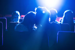 Couple kissing at the cinema. Romantic loving couple kissing at the cinema, love and relationships concept Royalty Free Stock Image