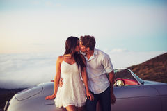 Couple Kissing with Classic Vintage Sports Car Royalty Free Stock Photos