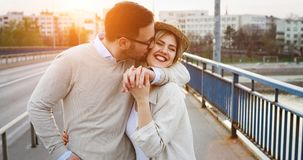 Couple kissing dating on bridge. During sunset Royalty Free Stock Photography