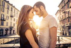 Couple kissing each other on a bridge over the river Stock Photo