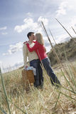Couple Kissing And Embracing On Beach Stock Photos